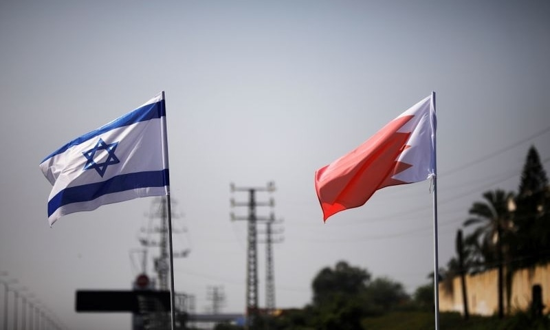 This file photo shows the flags of Israel and Bahrain along a road in Netanya on September 14. — Reuters