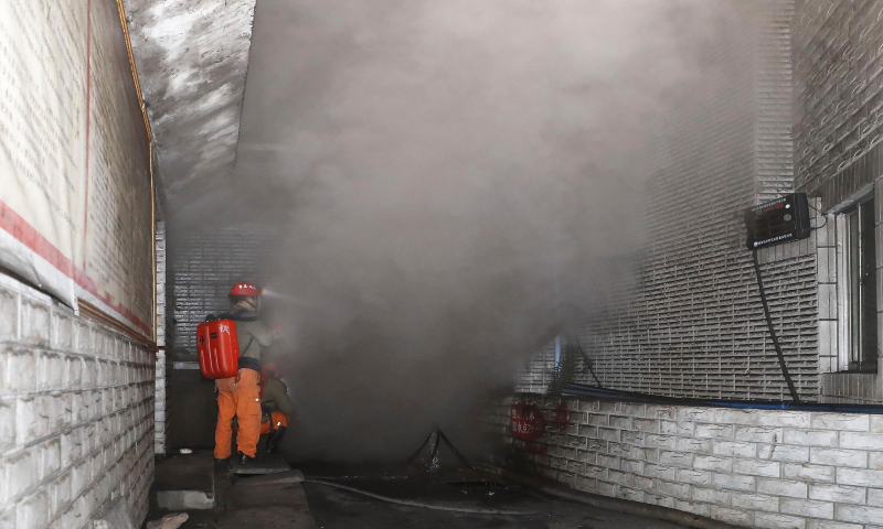 In this photo released by Xinhua News Agency, rescue workers gauge the density of carbon monoxide in the smog at the entrance of the coal mine in Yongchuan District of Chongqing on Dec 4. — AP