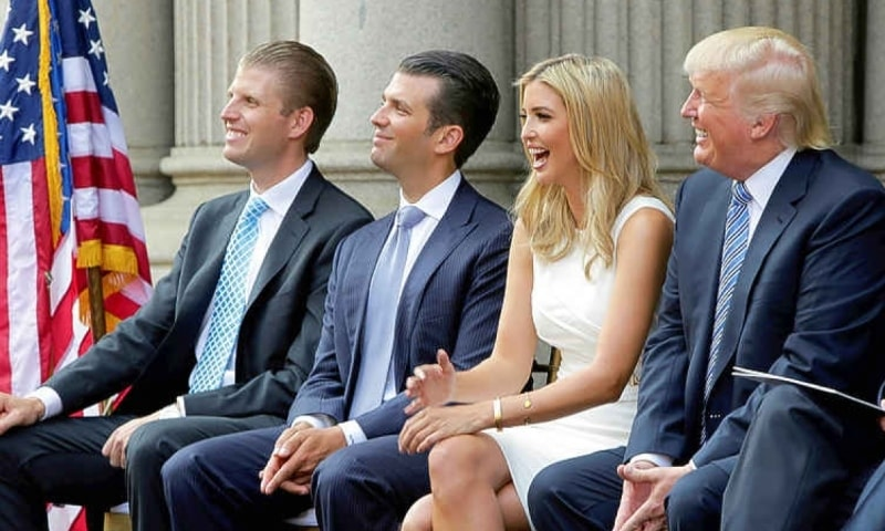 L-R) Eric Trump, Donald Trump Jr., and Ivanka Trump and Donald Trump attend the ground breaking of the Trump International Hotel at the Old Post Office Building in Washington on July 23, 2014. — Reuters