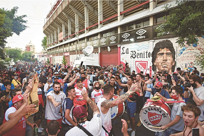 People gather to mourn the death of the football legend outside the Diego Armando Maradona stadium in Buenos Aires, Argentina | Reuters