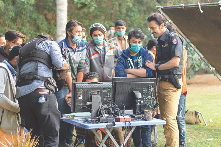 Zahid Ahmed with the production crew on set