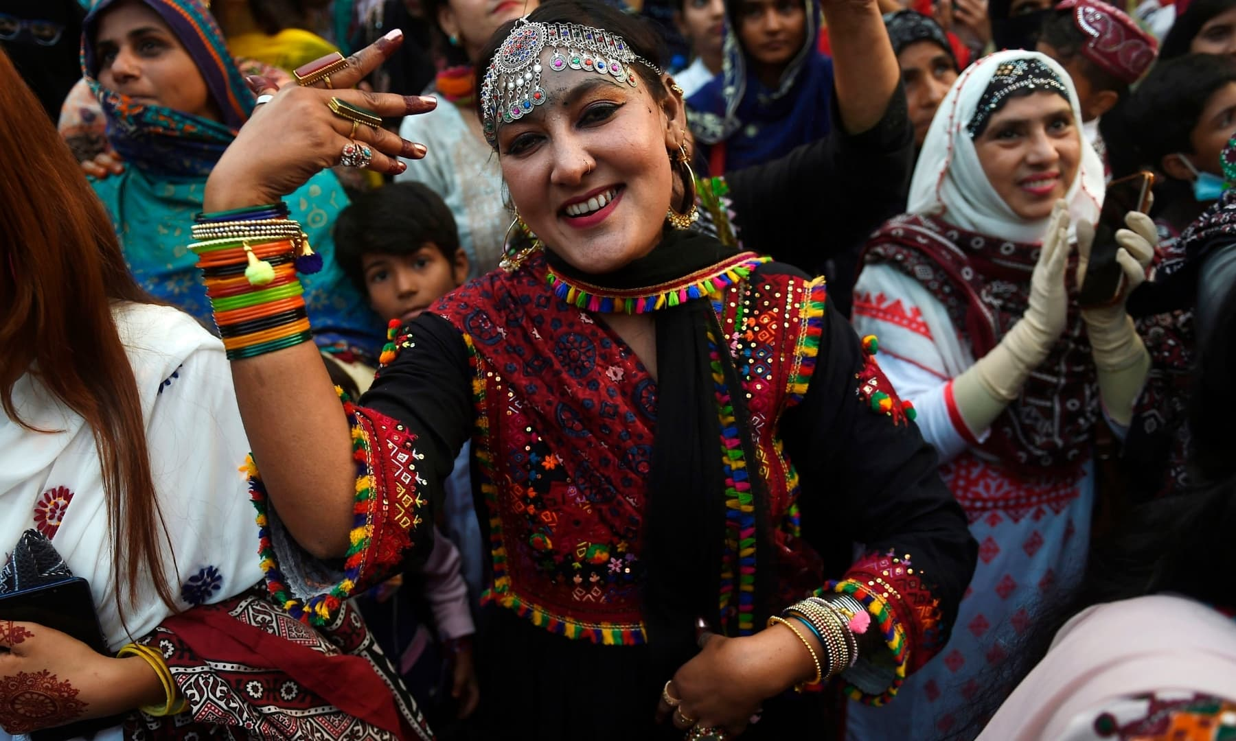 People wearing traditional dresses gather to celebrate the Sindh Culture Day in Karachi. — AFP