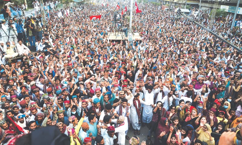JUBILANT participants pack the venue outside Karachi Press Club on Sunday to celebrate Sindh Culture Day.—Photo by Shakil Adil / White Star