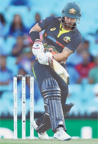 SYDNEY: Australia's stand-in captain Matthew Wade plays a shot during the second T20 International at the Sydney Cricket Ground on Sunday.—AFP