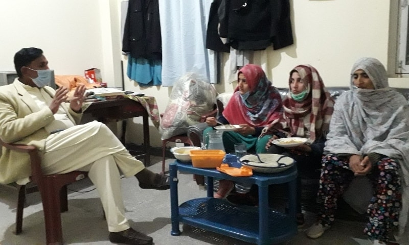 Abbaspur Assistant Commissioner Tassawar Kazmi speaks to Laiba and Sana at the police station. — Photo provided by author