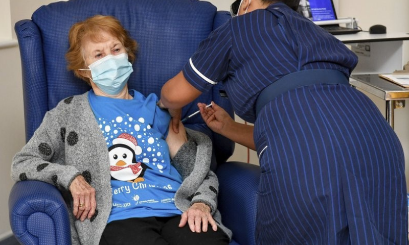 90 year old Margaret Keenan, the first patient in the UK to receive the Pfizer-BioNTech Covid-19 vaccine, administered by nurse May Parsons at University Hospital, Coventry, England on December 8, 2020. — AP