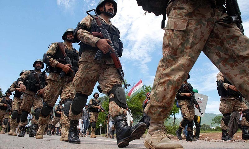 Pakistan Army soldiers moving ahead to stop the activists of PAT and PTI from moving ahead, in Islamabad. — Online/File