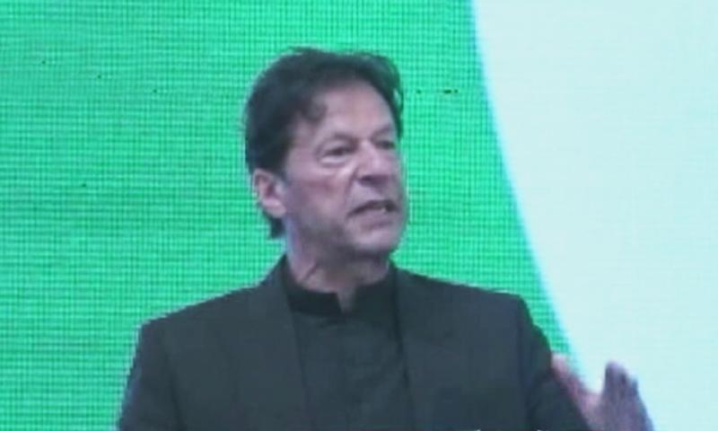 Prime Minister Imran Khan addresses a cheque distribution ceremony. — DawnNewsTV