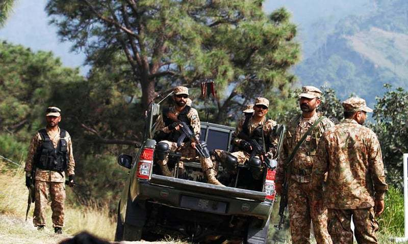 Pakistan Army soldiers patrol on the Line of Control.— AP/File