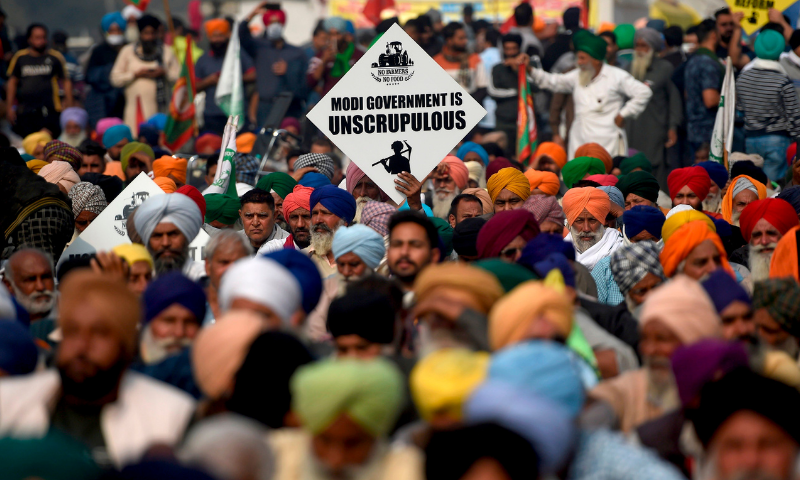 Farmers listen to a speaker as they take part in a protest against the central government's recent agricultural reforms at the Delhi-Haryana state border in Singhu on December 4, 2020. — AFP/File