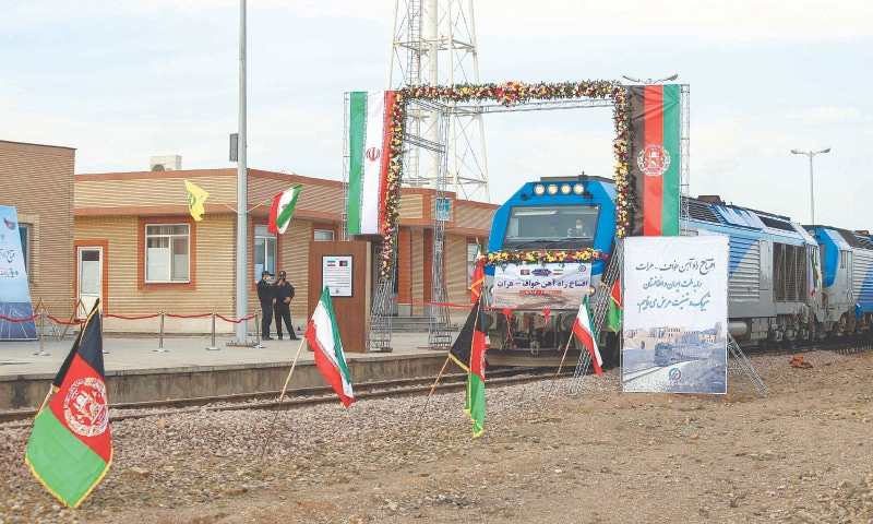 A TRAIN moves into western Afghanistan from eastern Iran during the inauguration of the service between the two countries on Thursday.—AFP