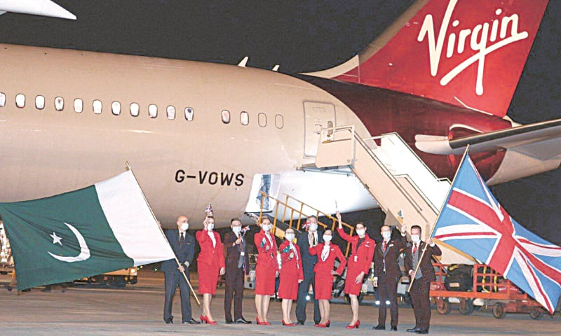 ISLAMABAD: Officials and staff of Virgin Atlantic pictured after the airline's first flight from Manchester landed at the Islamabad International Airport on Friday. The official Twitter handle of the airline said they were thrilled for the maiden flight to Pakistan.