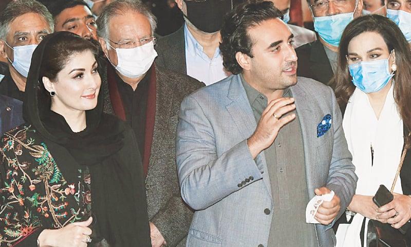 PML-N vice president Maryam Nawaz and PPP chairman Bilawal Bhutto-Zardari talking to reporters at Raiwind on Friday. — Arif Ali / White Star