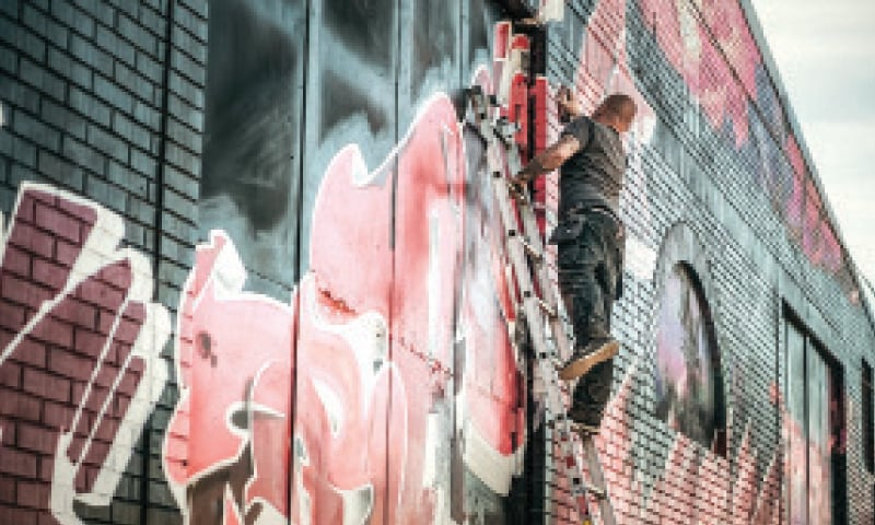 Painting a graffiti design is a labour of love