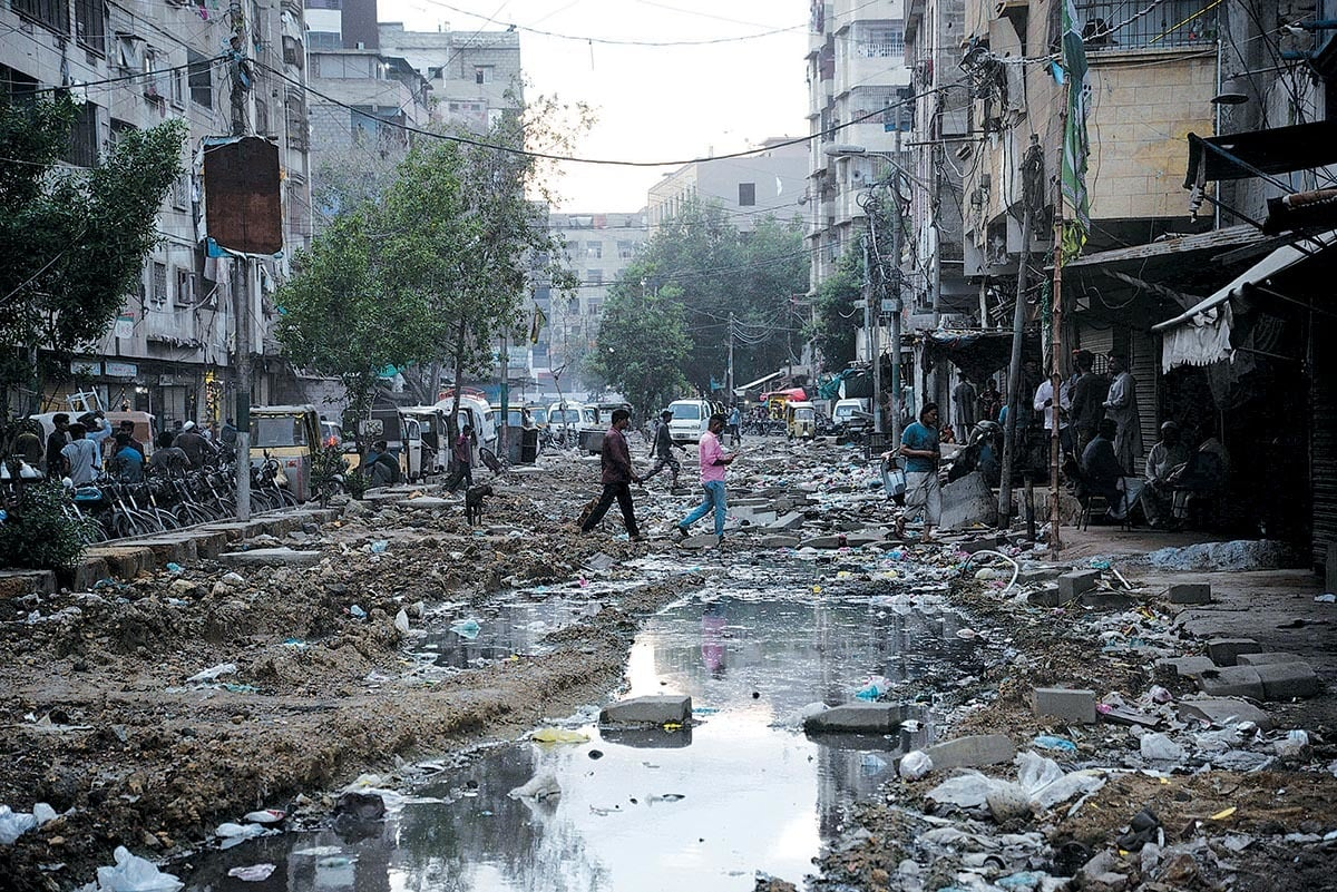 A file photo showing the impact of unfinished work on a sewage line in Karachi's Ramaswami area | Shakil Adil/White Star