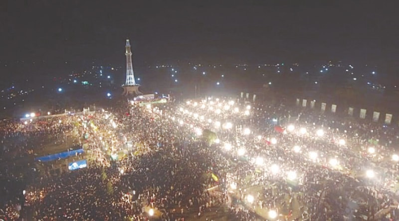LAHORE: PDM supporters attend the public meeting at Minar-i-Pakistan on Sunday.—M. Arif / White Star