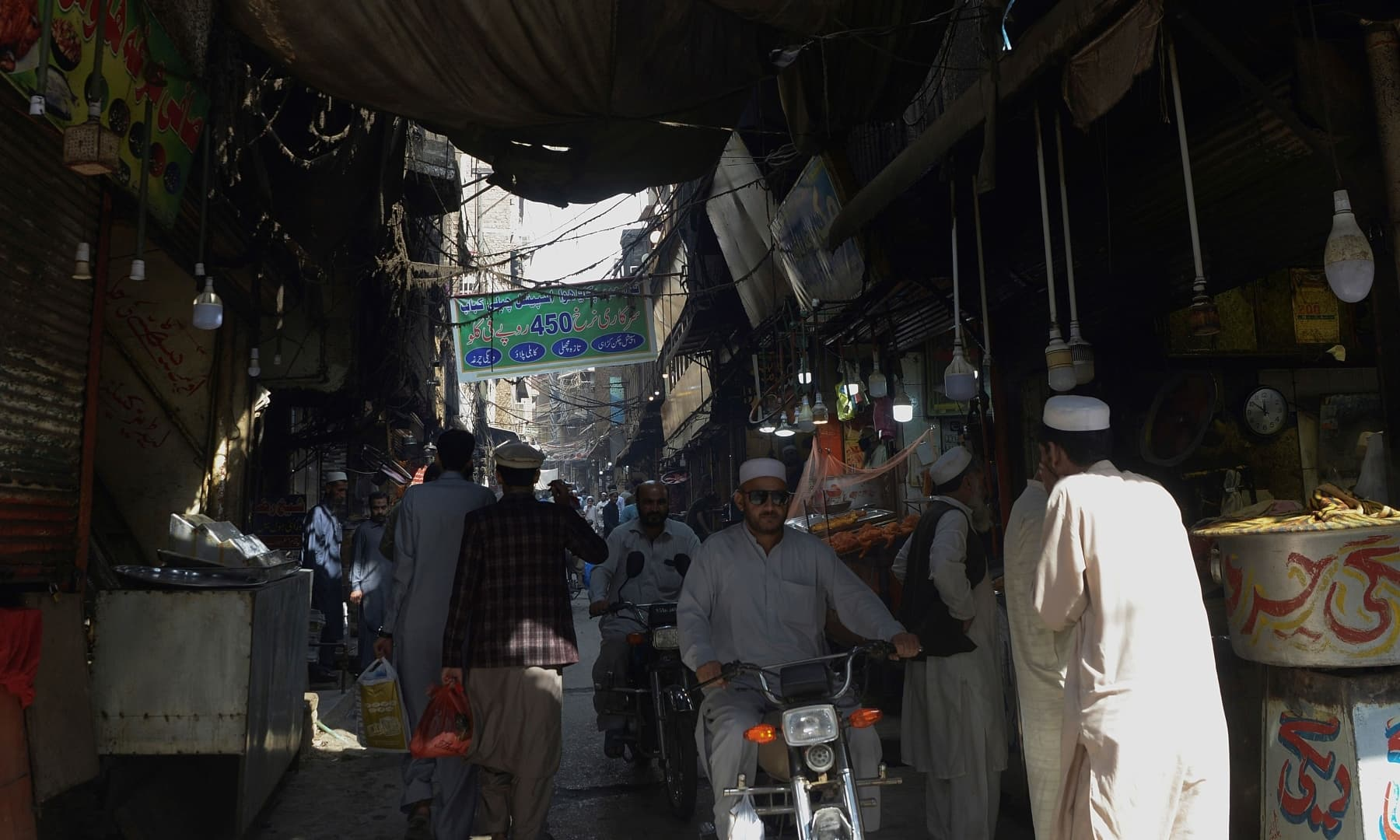 "In this picture taken on October 28, residents visit the oldest Qissa Khawani or ""storytellers bazaar"" in Peshawar. — AFP"