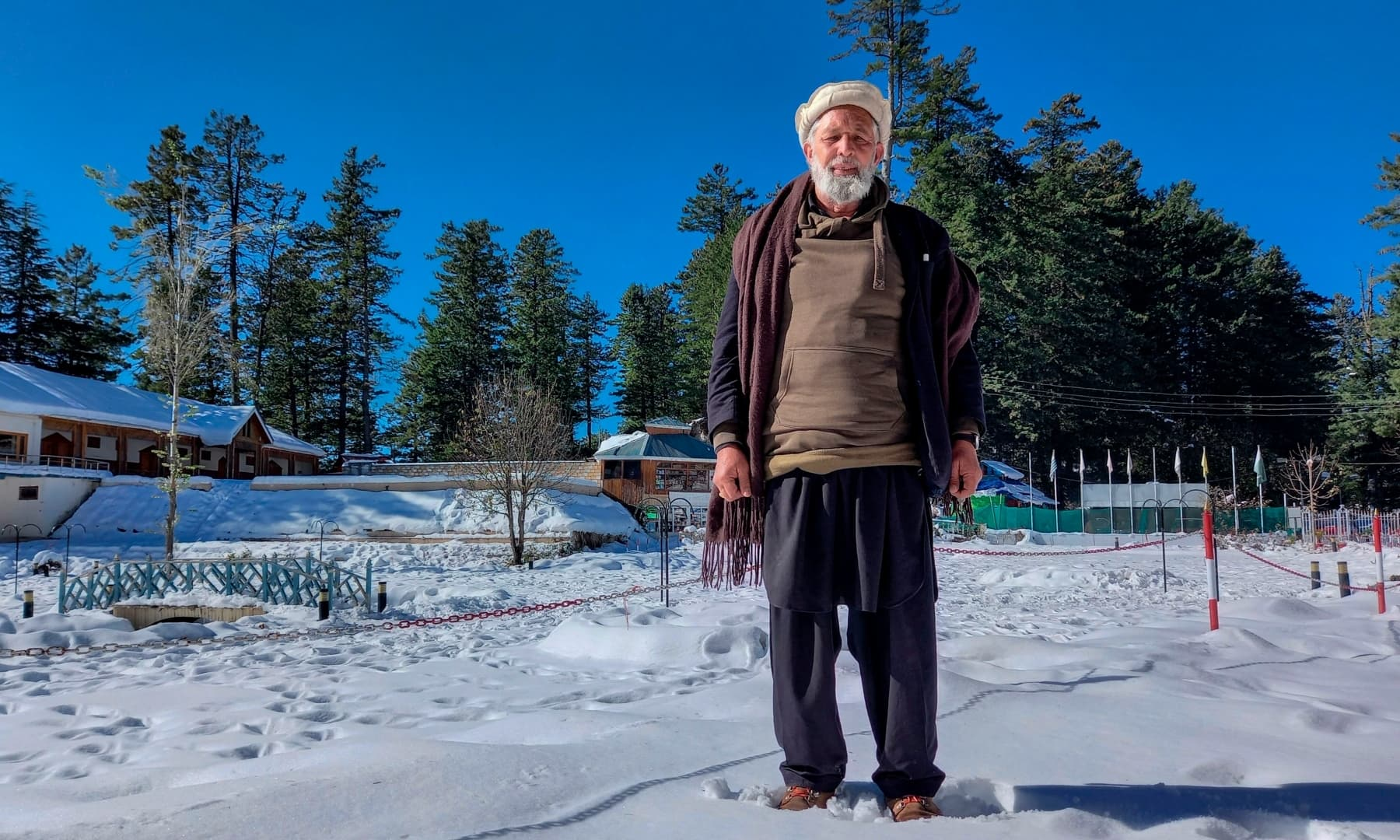 In this picture taken on November 21, 2020, Mohammad Naseem poses for a photograph in the Shogran hill area in Kaghan Valley. — AFP