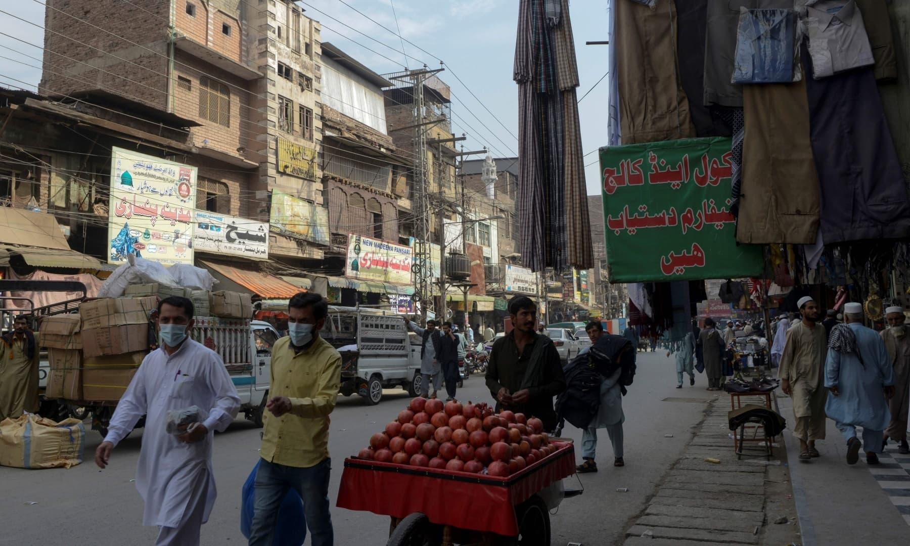 "Residents walk through the Qissa Khawani or ""storytellers bazaar"" in Peshawar. — AFP"