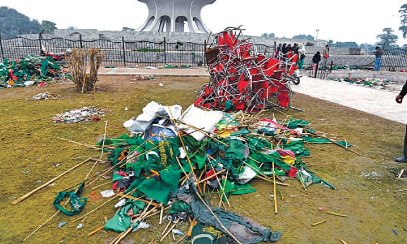 Piles of broken chairs, fence, party flags and flexes litter the Greater Iqbal Park on Monday, a day after the Pakistan Democratic Movement rally. — White Star
