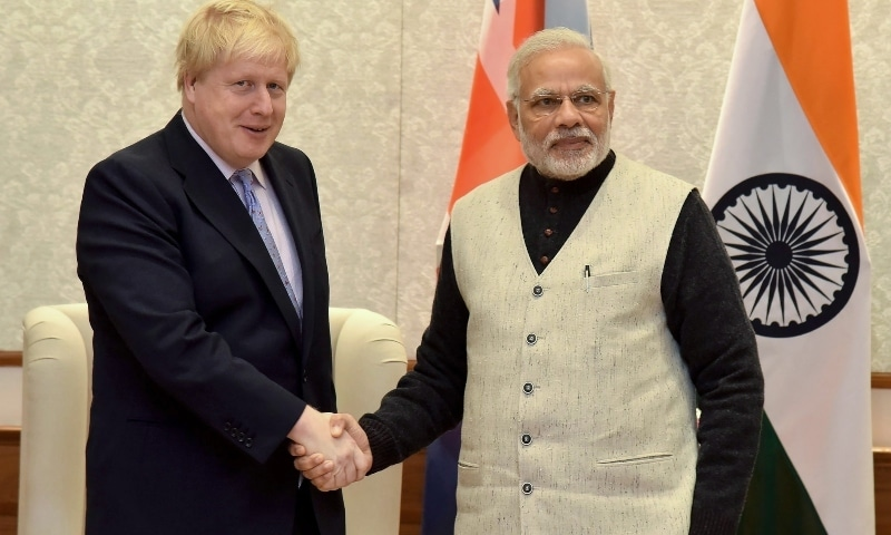 In this January 18, 2017, file photo, then-British foreign secretary Boris Johnson (L) shakes hands with Indian Prime Minister Narendra Modi (R) in New Delhi. —AFP/PIB