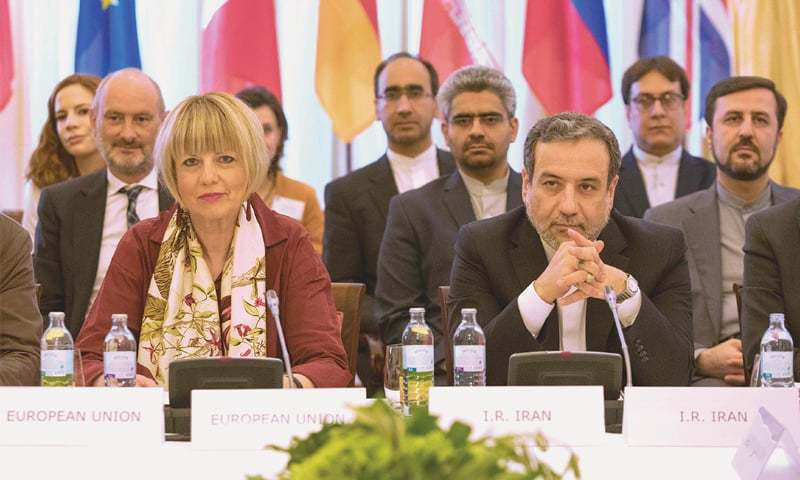 In this file photo,  Abbas Araghchi (right), an official at Iran's ministry of foreign affairs, and Helga Schmid, Secretary General of the European Union's external affairs department, take part in a meeting  to discuss the 2015 nuclear deal between the West and Tehran.— AFP