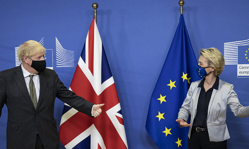 Britain's Prime Minister Boris Johnson (L) is welcomed by European Commission President Ursula von der Leyen in the Berlaymont building at the EU headquarters in Brussels on December 9, prior to a post-Brexit talks' working dinner. — AFP/File
