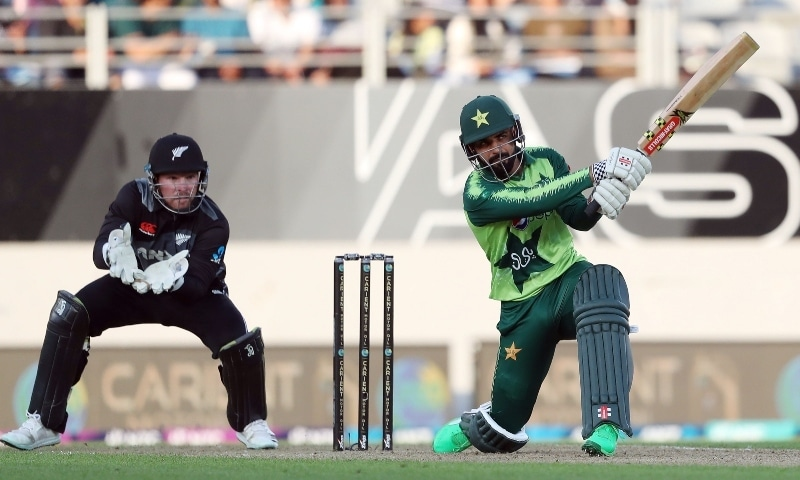 Shadab Khan bats as New Zealand's wicketkeeper Tim Seifert (L) looks on during the first T20 international cricket match between New Zealand and Pakistan at Eden Park in Auckland on December 18.  — AFP