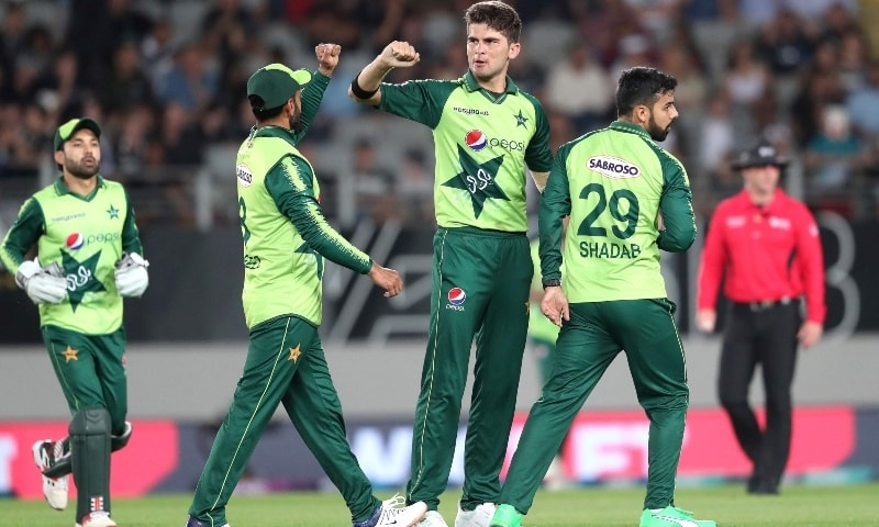 Shaheen Shah Afridi (C) celebrates the wicket of New Zealand's Tim Seifert with teammates during the first T20 international cricket match between New Zealand and Pakistan at Eden Park in Auckland on December 18. — AFP