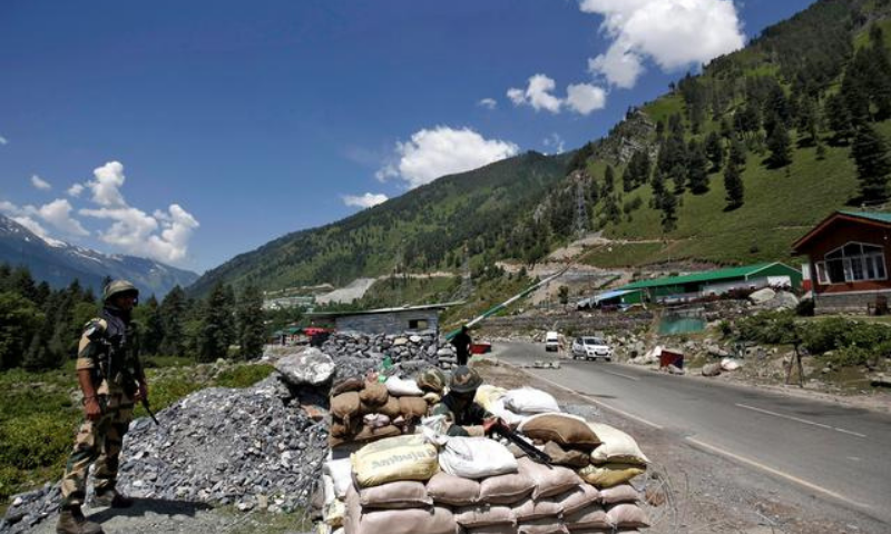 India's Border Security Force (BSF) soldiers stand guard at a checkpoint along a highway leading to Ladakh, at Gagangeer in Kashmir's Ganderbal district. — Reuters/File