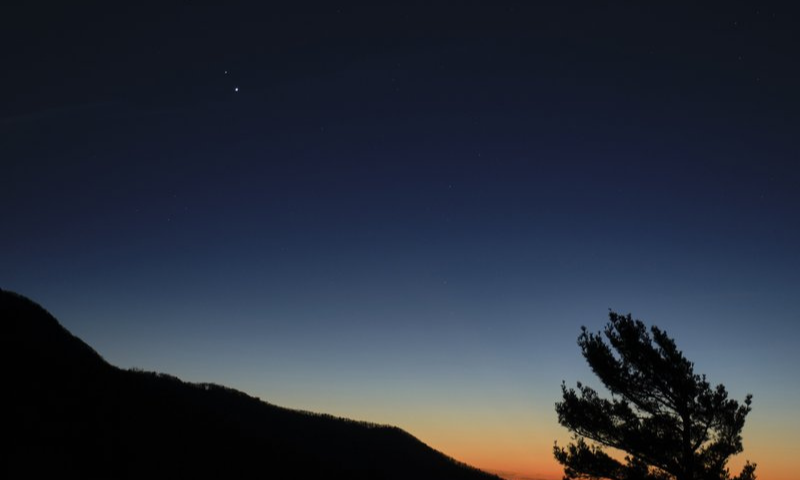 In this Dec 13 photo made available by Nasa, Saturn, top, and Jupiter, below, are seen after sunset from Shenandoah National Park in Luray, US. — AP/File