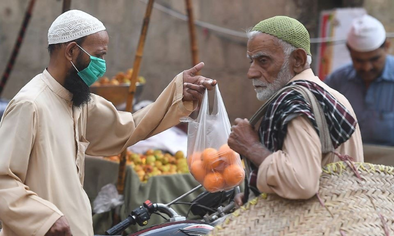 In this file photo, a man shops for fruits in a bazaar in Rawalpindi. — AFP