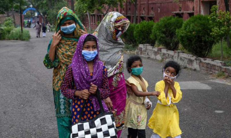 With 31 more Covid-19 deaths, Punjab reported 831 new cases, the highest number in a day in the second wave of the Covid-19 so far, showing a persistent surge in the confirmed cases of the virus in the province. — AFP/File