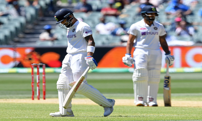 India's Virat Kohli, left, begins to walk off after he was caught out for 4 runs against Australia on the third day of their cricket test match at the Adelaide Oval in Adelaide, Australia, Saturday, Dec 19. — AP
