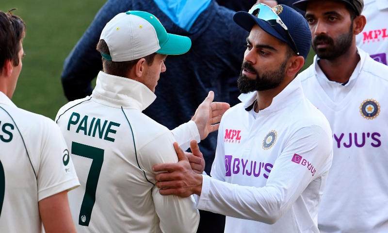 India's captain Virat Kohli (2/R) congratulates Australia's captain Tim Paine (2/L) on the third day of the first cricket Test match between Australia and India played in Adelaide on December 19. — AFP