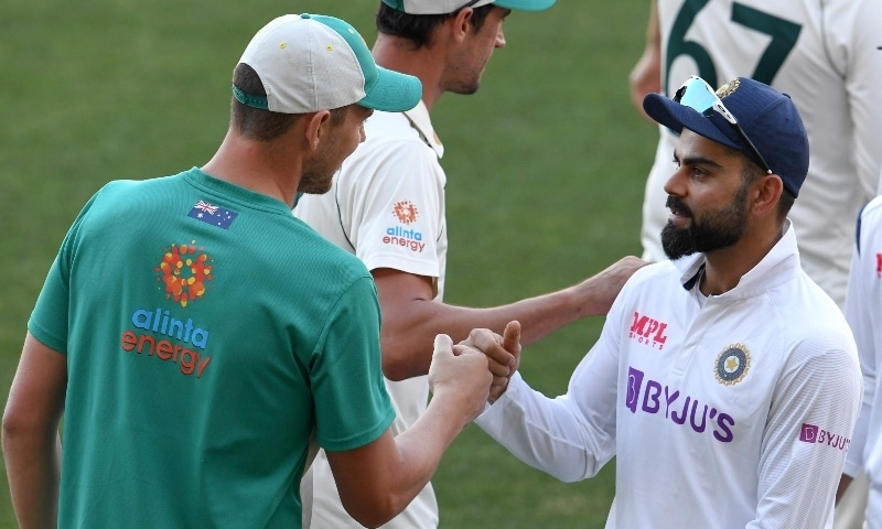 India's Virat Kohli (R) congratulates Australia's Josh Hazlewood on the third day of the first cricket Test match between Australia and India in Adelaide on December 19. — AFP