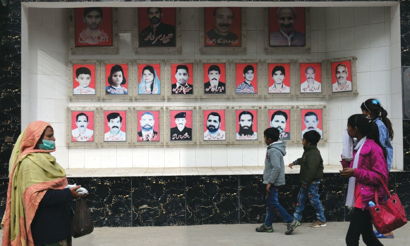 Pictures of those who lost their lives in the 2015 Easter attacks hang outside Christ Church in Youhanabad, Lahore | Murtaza Ali/White Star