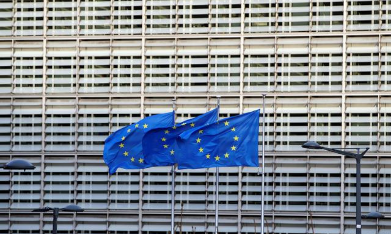 European Union flags flutter outside the European Commission headquarters, where Brexit talks are taking place, in Brussels, Belgium. — Reuters/File