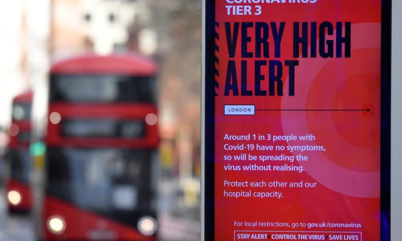 A British government health information advertisement highlighting new restrictions amid the spread of the coronavirus disease (COVID-19) is seen in London, Britain, December 19. — Reuters