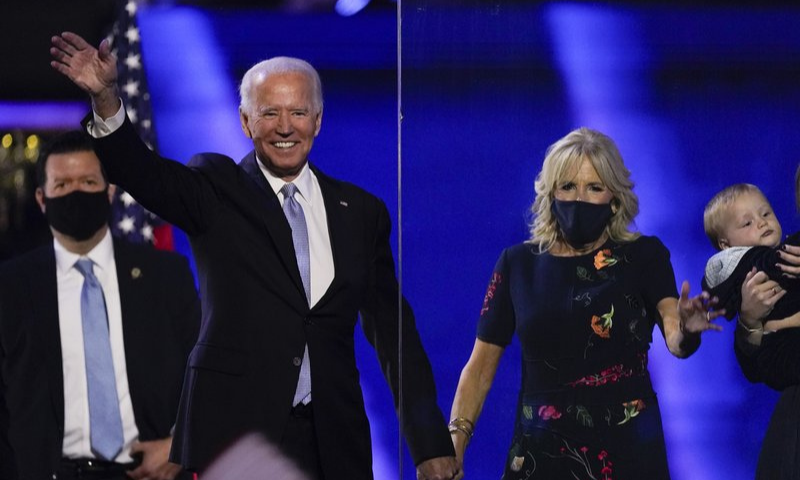President-elect Joe Biden stands on stage with his wife Jill on Nov 7 in Wilmington, US. — AP
