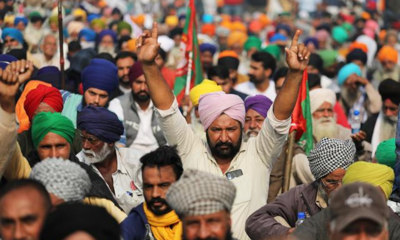 Farmers protest against the newly passed farm bills at Singhu border near Delhi, India, December 4. — Reuters