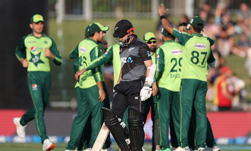 New Zealand's captain Kane Williamson (C) walks back to the pavilion as Pakistan's players celebrate his dismissal during the third T20 cricket match between New Zealand and Pakistan at McLean Park in Napier on Tuesday. — AFP