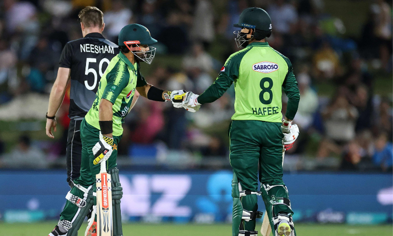 Pakistan batsman Mohammad Rizwan (L) celebrates hitting a six with a teammate Mohammad Hafeez during the third T20 cricket match between New Zealand and Pakistan at McLean Park on Tuesday. — AFP