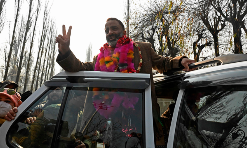 Salman Sagar, National Conference candidate for the state Urban Local Bodies (ULB) polls celebrates after he won a ULB seat outside a counting center in Srinagar on December 22. — AFP