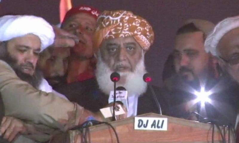 PDM chief Maulana Fazlur Rehman speaks to the participants of the PDM's rally in Mardan. — DawnNewsTV