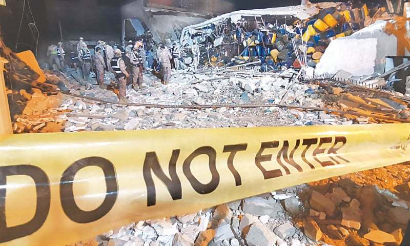 Law enforcers and rescuers at the site of the explosion on Tuesday evening.—INP/File