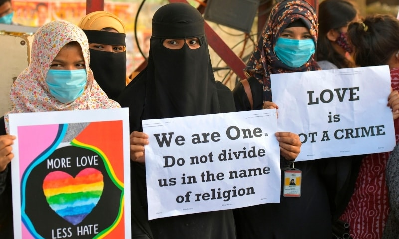 "In this December 1, 2020, photo, activists belonging to various human and civil rights organisations hold placards during a demonstration condemning the decision of various BJP-led state governments in the country for the proposed passing of laws against ""Love Jihad"" in Bangalore. — AFP"