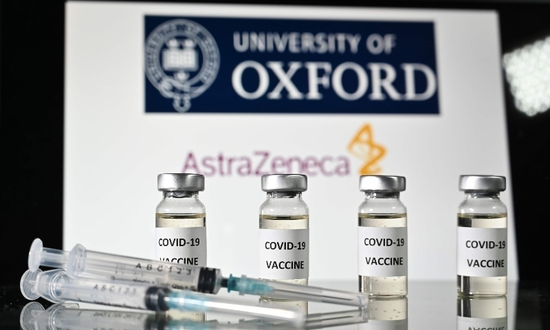 In this file photo taken on November 17, an illustration picture shows vials with Covid-19 Vaccine stickers attached and syringes, with the logo of the University of Oxford and its partner British pharmaceutical company AstraZeneca. —  AFP