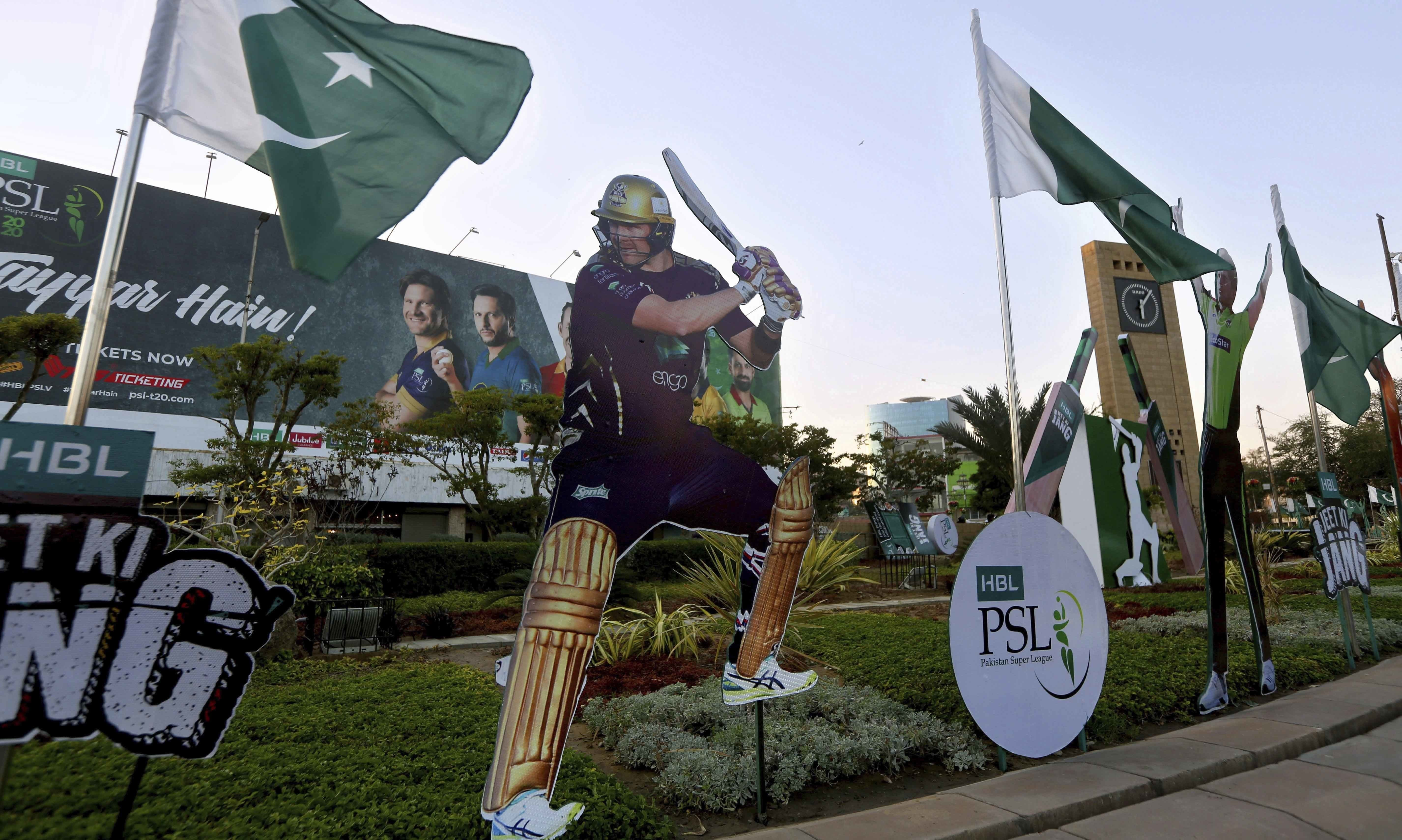 This file photo shows a cut-out of a cricketer Shane Watson of Australia, displayed along a roadside in Karachi. — AP/File