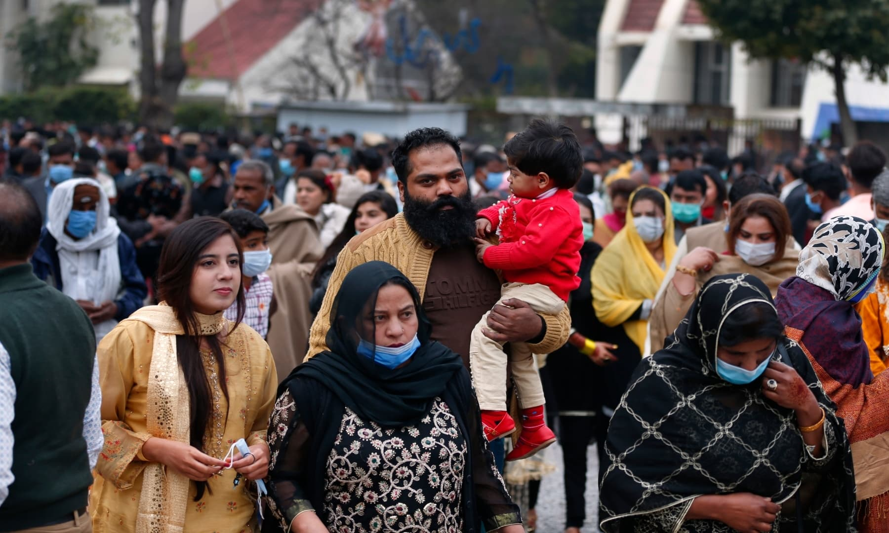 Christians leave after attending a Christmas mass in Our Lady of Fatima Church in Islamabad on Friday, Dec 25. — AP